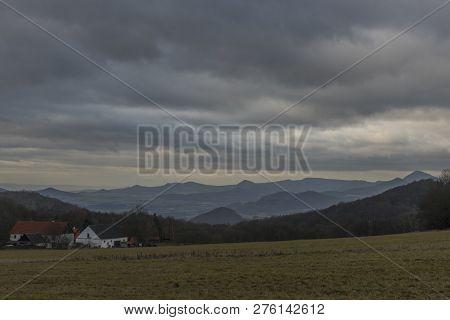 Panorama View Near Nemci Village In Ceske Stredohori Mountains In Winter Dark Day