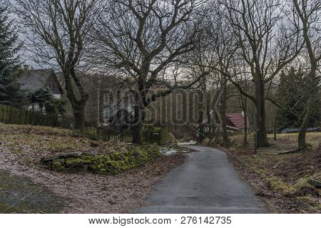 Houses In Nemci Village In Dark Grey Winter Day In Ceske Stredohori Mountains
