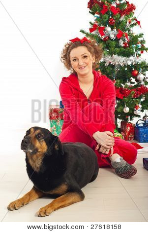 Woman With Dog By Christmas Tree