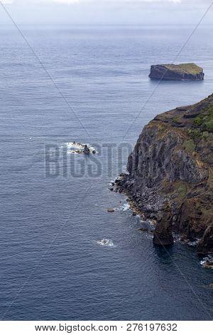 Dramatic Coastline With Small Islands Off The Coastline Near Mosteiros On Sao Miguel.