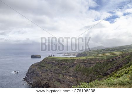 Small Islands And Rocky Coastline Near Mosteiros On The Island Of Sao Miguel In The Azores.