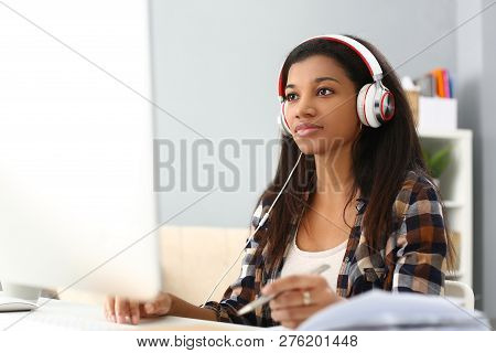 Black Ordinary Female Designer Workplace Portrait At Home Remote Education Concept. Holds Silver Pen