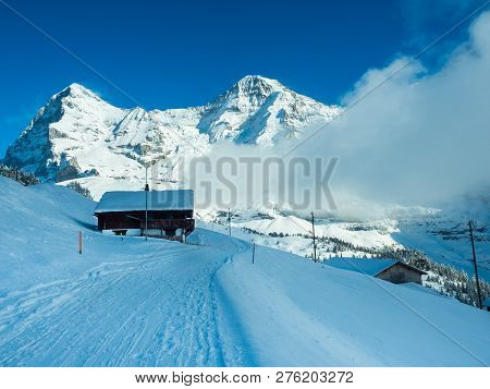 Winter View Of The Beautiful Panorama Of Eiger Peak, Monk Mountain Peaks. Swiss Alps