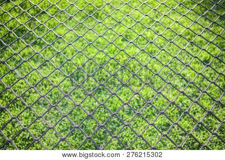 Hang Bended White Black Soccer Nets Soccer Football Net. Grass On Football Playground In The Backgro
