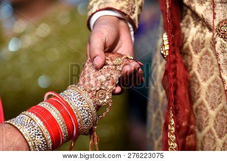 Bride & Groom Hand' Together In Indian Wedding