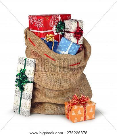 Santas Christmas Present Burlap Sack Full Of Beautiful Present Boxes Isolated On White