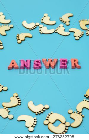 Answer Search Concepts. Concepts Search Answer. Footprints And The Word Answer On A Blue Background.