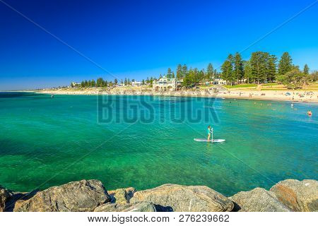 Cottesloe, Western Australia - Jan 2, 2018: Woman Practices Sup Surf On Calm Waters Of Cottesloe Bea