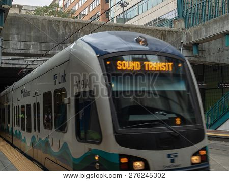 Seattle, Wa August 26, 2018: Sound Transit Link Light Rail Pulling Into Outdoor Station