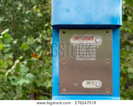 Emergency Button, Info Button And Speaker On A Blue Emergency Light Post