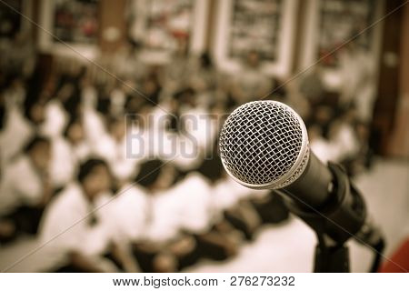 Audience Listening Speaker Speech In Conference Hall Or Seminar Room With Blur Light People Backgrou