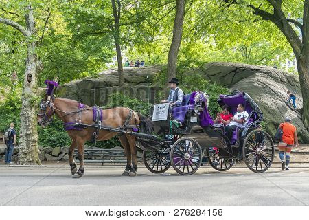New York, Usa - May 21, 2018: People On Horse Carriage Ride In Central Park Of New York City. It Is