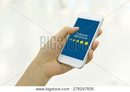 Customer Satisfaction Review Business Concept. Woman Hand Using Smartphone With Satisfaction Rating