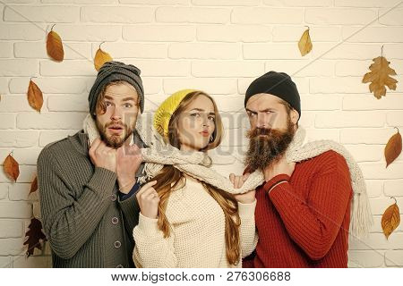 Season And Autumn Holiday. Friendship And Relations. Girl And Men At Seasonal Brick Wall. Sad, Serio