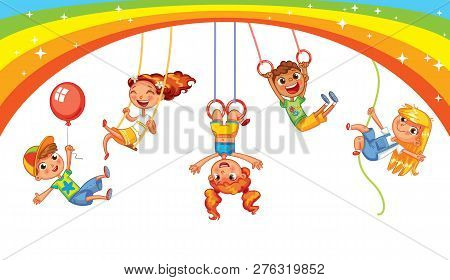 Children Have Fun On The Rides. Amusement Park. Playground. Kid Weighs On The Rings Upside Down. Cli
