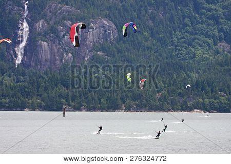 Kitesurfers Riding On The Howe Sound At Squamish, Canada