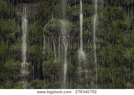 Cascade With Waterfalls On Prucelsky Creek In Ceske Stredohori Mountains In Winter Dark Cloudy Day