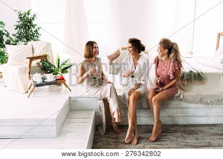 Russia, Orenburg -july 21, 2018: The Bride And Her Friends Drinking Champagne. The Friends Of The Br