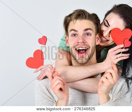 Valentines Day And Love. Man And Woman Couple In Love Hold Red Heart Valentines Cards White Backgrou
