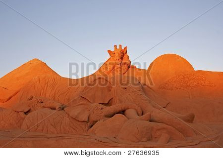 Giraffe and elephants in the desert