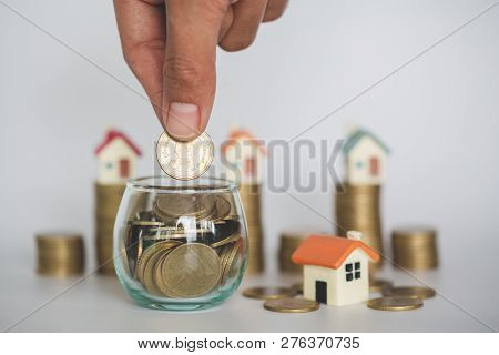 Hand Putting Money Coin Stack ,  Buy A House,risk,  Indicates The Growth Of Home And Finance, Planni
