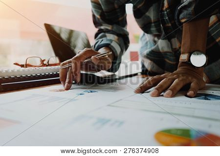 Businessman Or Accountant Hand Holding Pen Working For Calculating Finance, Tax, Accounting. Busines