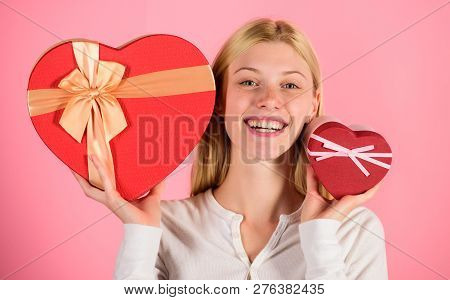 Woman Hold Big And Little Heart Shaped Gift Boxes. Which One She Prefer. Girl Decide Which Gift She