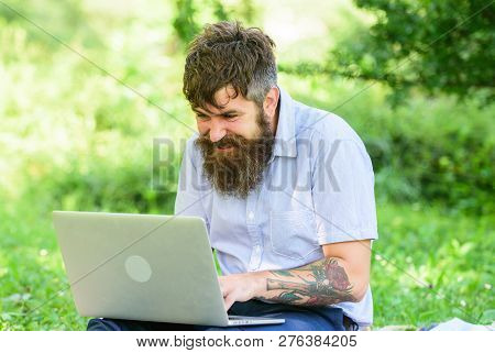 Blogger Becoming Inspired By Nature. Man Bearded With Laptop Sit Meadow Nature Background. Writer Lo