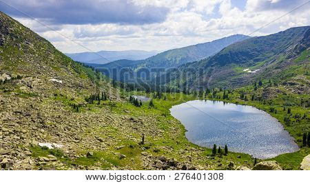 Mountain Landscape. Idyllic Summer Landscape With Clear Lake And Mountain Range In Natural Park Erga