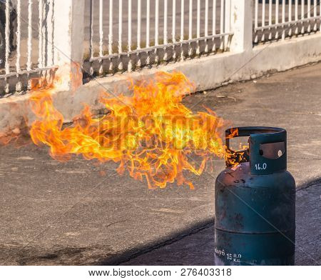 Gas Tank With A Burning Flame Background