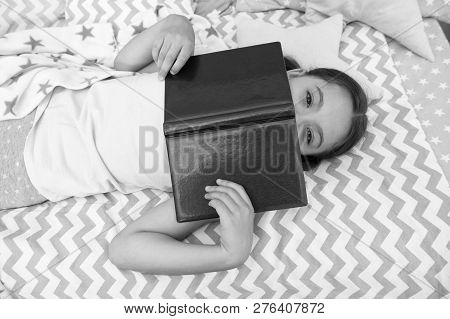 Girl Child Lay Bed Read Book Top View. Kid Prepare To Go To Bed. Pleasant Time In Cozy Bedroom. Girl