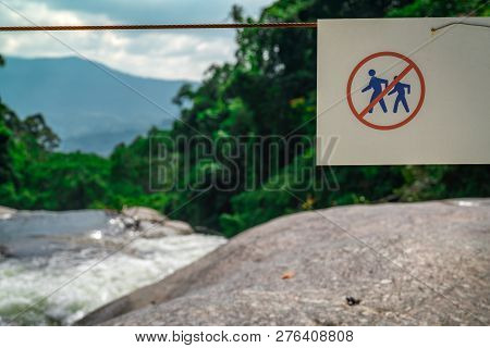 Do Not Walk Of The Trail. Warning Sign In National Park At Waterfall In Green Tropical Forest And Mo
