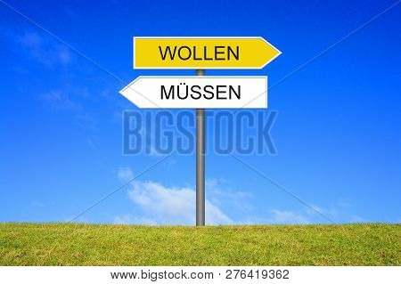 Signpost Outside Is Showing Must Or Want In German Language
