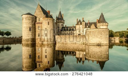 Castle Or Chateau De Sully-sur-loire In Sunset Light, France. This Old Castle Is A Famous Landmark O
