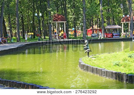 Kharkiv / Ukraine. 07 August 2016: Lake With Arbor In City Park. People Have A Rest In Gorky Park In