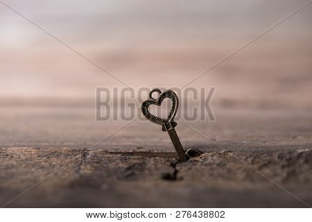 Key With Two Hearts As A Symbol Of Love On The Yelow Background. Key Of My Heart Concept. Love Valen