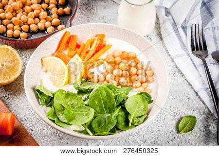 Modern Vegan Food, Savory Yogurt Bowl With Beans, Chickpeas, Spinach, Spicy Carrots, Lemon, Gray Sto