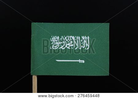 A Official And Unique Flag Of The Kingdom Of Saudi Arabia On Toothpick On Black Background. A Green