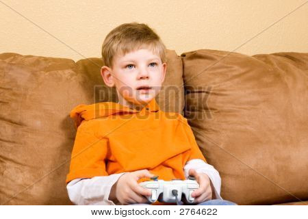 Happy Young Boy Playing Video Game