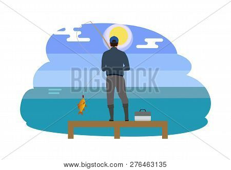 Man Standing On Wooden Pier With Tackle Box. Person Wearing Waders High Wellingtons. Fisherman Catch