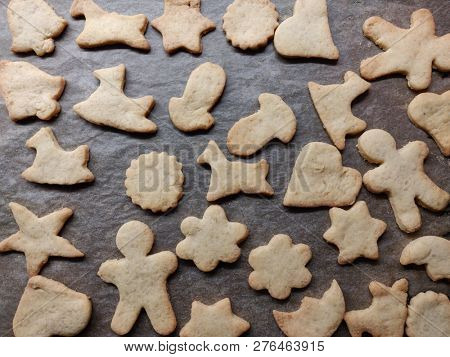 flat lay home made cookies with different shapes on a baking tray