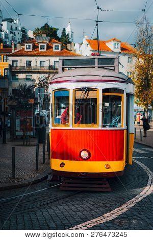 Vintage Old Red Tram In The City Center Of Lisbon. City Touristic Landmarks Of Lisboa Lissabon, Port