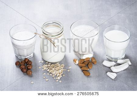 Vegan Non Dairy Alternative Milk. Coconut, Almond, Hazelnut, Oat Homemade Milk On Stone Table. Top V