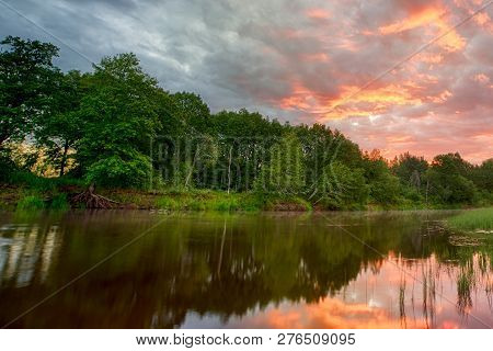 Sunset Long The Banks Of The Amazon River. The Tributaries Of The Amazon Traverse The Countries Of G