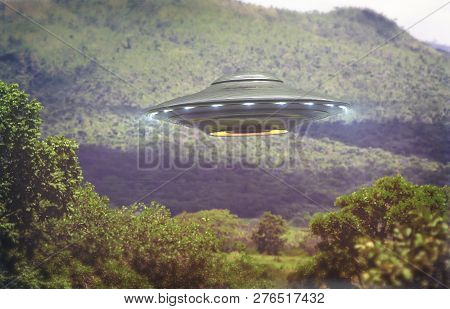 Unidentified Flying Object Over A Forest With Trees And Mountains Behind. Old Style Photo With High