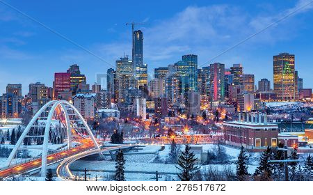 Edmonton Downtown Winter Skyline Just After Sunset At The Blue Hour Showing Walterdale Bridge Across
