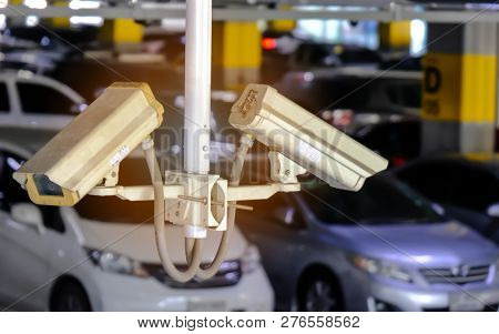 2 Cctv Or Close Circuit Television Are Monitor And Record Cars In Parking Lot Of Shopping Mall To Pr