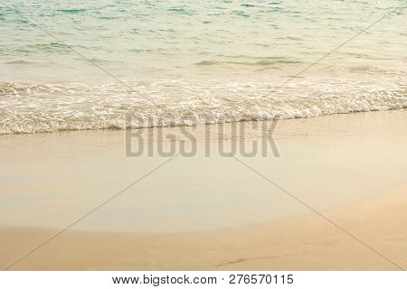 Small Waves On The Beach At Afternoon, Soft Wave Of The Sea On The Sandy Beach, Selective Focus