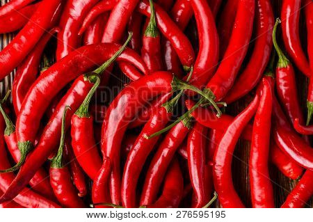 Red Hot Chilli Peppers Pattern Texture Background. Close Up. A Backdrop Ofred Hot Chilli Peppers