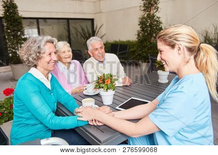 Nursing home care for seniors in the lounge in the retirement home